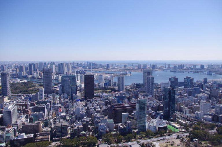 A view from Tokyo Tower, Odaiba in the background and part of Tokyo Bay with Rainbow Bridge